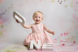 Helen Rowan Phototography Indoors first birthday studio happy sitter